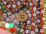 ちりめん生地・彩り縞に小桜(赤さび色)