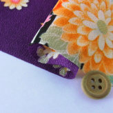 一越ちりめん・扇に菊と牡丹(紫)