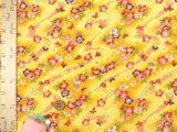 ちりめん生地・らせん流水に花と蝶(黄色)