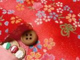 ちりめん生地・桜とリボン蝶(赤)